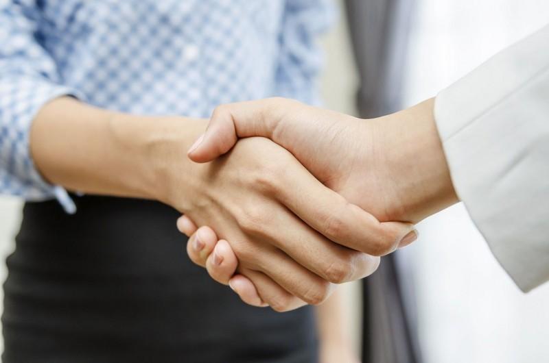 Businesswomen handshake